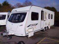 2010 Lunar Delta TI Twin Axle, FIXED ISLAND BED. Alde central heating. 4 Berth Touring Caravan.