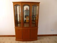 Morris crafted Bow fronted display cabinet with mirror, lights, glass shelves and storage shelves.