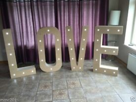 Heart shaped Donut wall and LOVE lights for hire ... and some bouncy castles too!!