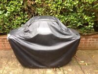 Gas Bbq with half full gas canister & cover