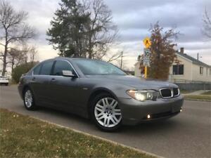 2003 BMW 745i = 154K= NAV = HEATED/AC/MESSAGING SEATS = LOADED..