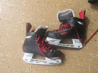 Various hockey equipment from the ages of 4-12