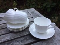 Wedgwood candlelight design fluted White cups (10) and saucers (14)