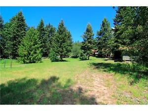 BEAUTIFUL SPRAWLING ACREAGE BACKING ONTO MISSION CREEK!