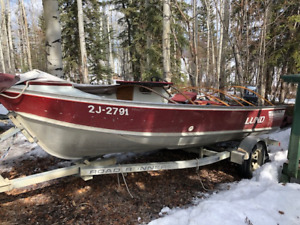 16 foot Lund Pike aluminium boat with 50 hp Yamaha outboard .