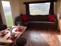 Cheap static caravan sited for sale on East Coast 12 month holiday park