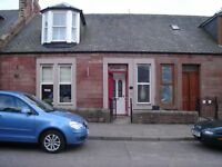 3/4 bed terraced house with 3 bathrooms ground floor wc with garage, sunroom and sunny garden