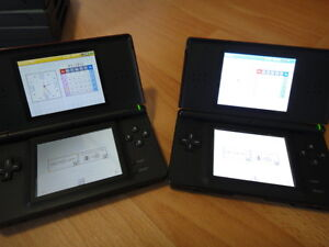 Two Nintendo DS handhelds plus games