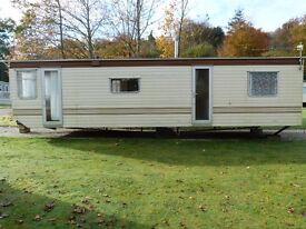 Static caravan 1995 2 bedroom 30ft x 10ft for sale. Buyer collects.