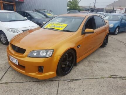 2010 Holden Commodore VE MY10 SV6 Orange 6 Speed Manual Sedan Fairfield East Fairfield Area Preview