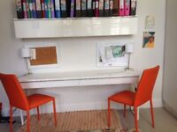 Ikea White Matching Desk, Wall Cabinet and 2 Orange leatherette chairs For Sale