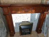 wooden fire surround with gas fire and marble hearth