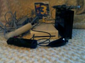 TWO WII CONSOLES ONE BLACK AND ONE WHITE PLUS EXTRAS