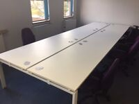 6 white office desks (fixed) and chairs