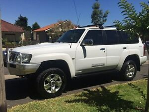 2008 Nissan Patrol GU 6 ST-L Wagon 7st 4dr Man 5sp 4x4 3.0DT White Manual Wagon Croydon Burwood Area Preview