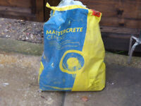Left over 1/4 bag of mastercrete cement Free to good home must be able to bond
