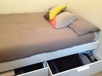 Double bed almost new with storage (Brimnes)