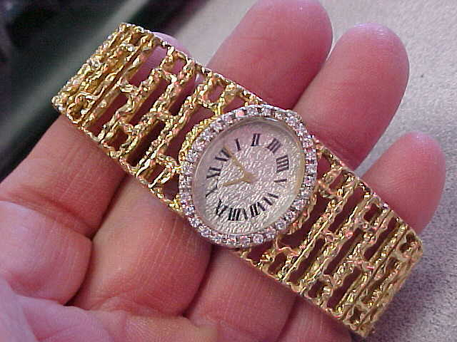 Beautiful ladies 14k Gold & Diamond Watch  58.9 grams  Mechanical wind up model