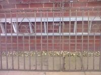 ANTIQUE WROUGHT IRON DRIVEWAY GATES IN NEED OF PAINTING