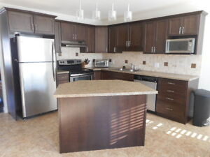 2000 sq. ft. Townhouse with heat pump! Maintenance free!