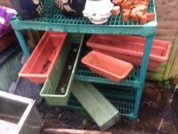 Green house potting table with pots and trays