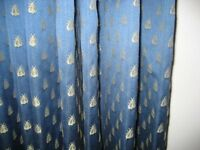 A BEAUTIFUL PAIR OF BLUE INTERLINED CURTAINS IN A MONKWELL FABRIC
