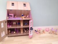Wooden kids dolls house with furniture