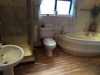 Bathroom suite (soft cream) including corner bath, sink, including taps, toilet, shower base & doors