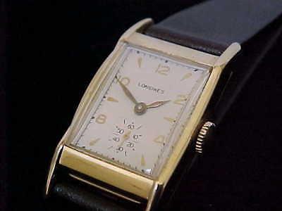 Fantastic 14 Karat Solid Gold Men's Rectangular Longines Wristwatch