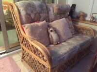 Conservatory suite. Settee and one armchair. Matching glass top coffee table. £40.00 ono