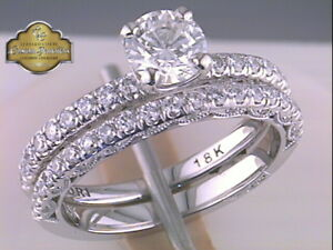 Tacori 18k engagement ring and matching wedding band.