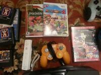 Nintendo Wii controller + 2 games for $35