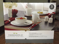 A SET OF BRAND NEW DINNER WARE SET BY '' THRESHOLD FOR SALE. ''