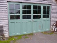 Set of 4 wooden folding door panels with glass panes.