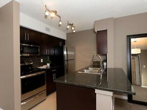 Brand New Condo MacTaggart South FREE U/G PARKING, INTERNET, TV
