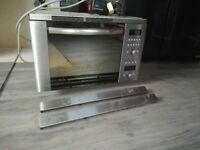 Integrated microwave oven and grill