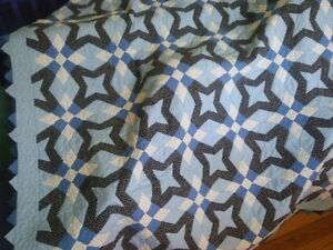 Beautiful Mennonite-made quilts for sale. Phone inquiries only.