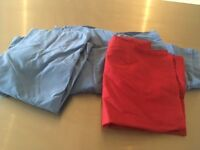 3 x unused pillowcases (2 blue, 1 red)