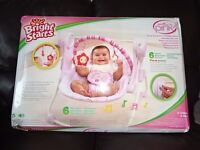 bright start swing ,plays, 6 melodies folds for storage