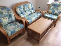 As new: full conservatory furniture set. One table, two Chairs, and a two-seater sofa