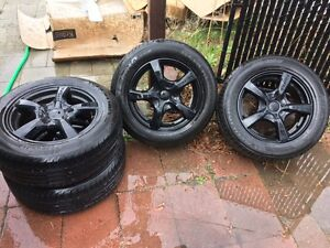 16in Black Touren rims with new tires