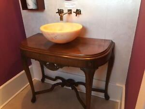 Antique vanity with vessel sink and faucet