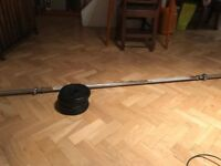 Barbell with 4x5kg disc weights