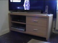 Television stand with two shelves and two large draws