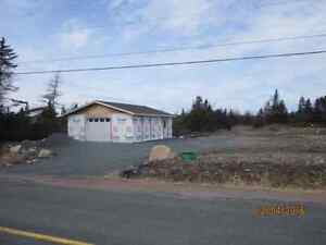 Land with a garage in Colinet!