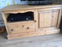 Pine TV stand with cupboard, drawer and shelf. Good condition