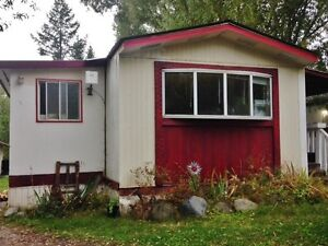 For sale or rent to own with many recent renos + lots of storage