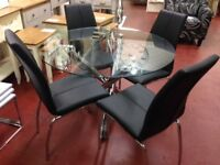 New round glass dining table with chrome legs & 4 chairs Only £329 available today