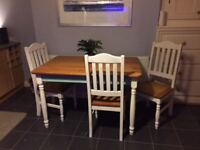 Solid dining table and 4 chairs, recently painted