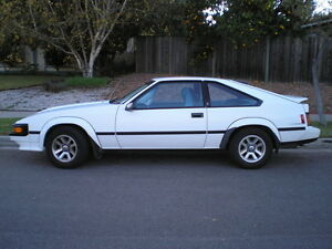 Parting Out 1985 Toyota Supra MKII, White/Burgandy Interior